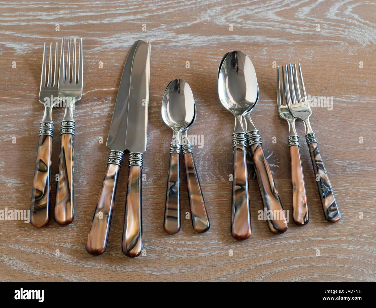 Flatware on wood table surface - Stock Image