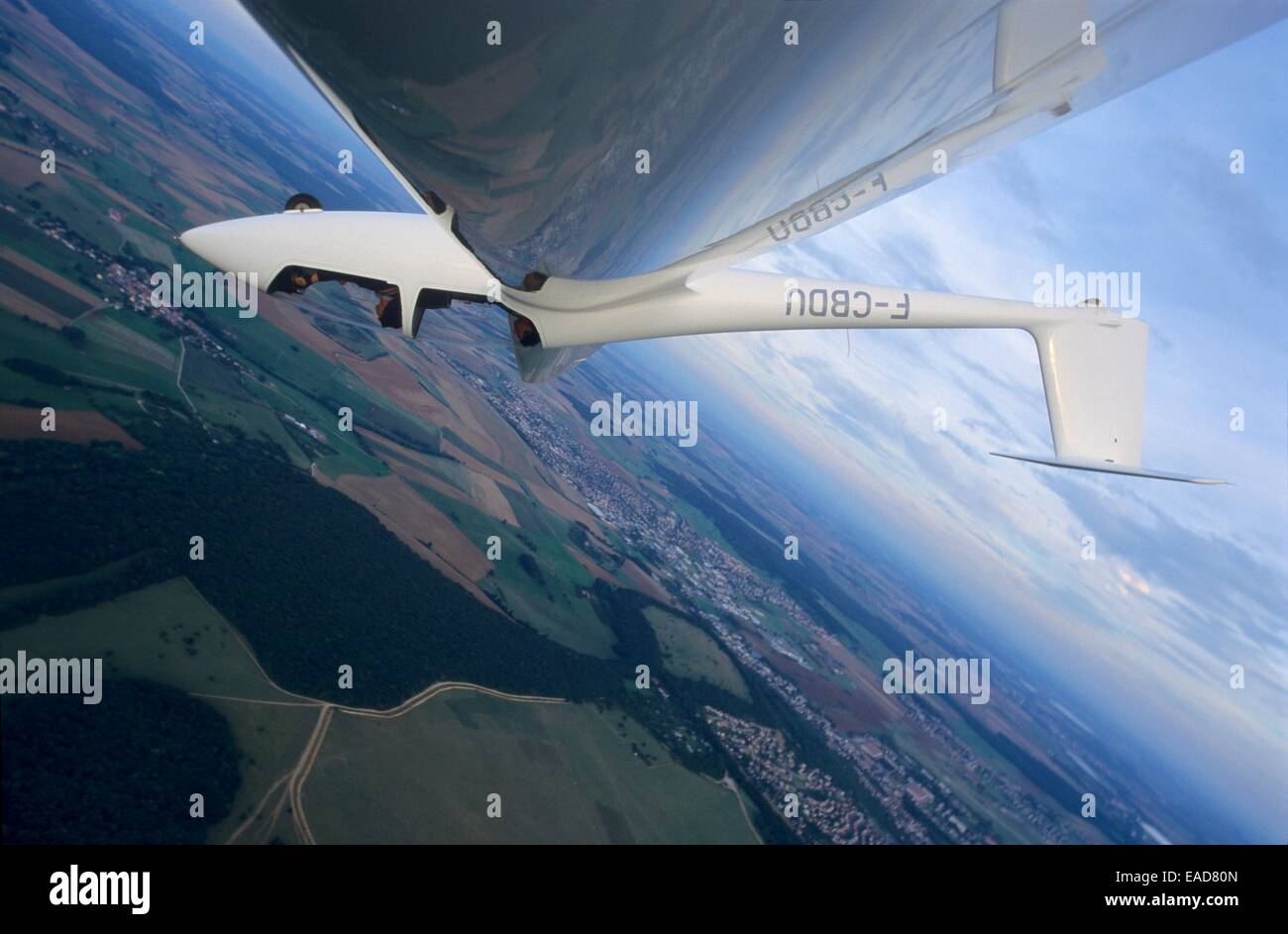 Glider plane in aerobatic flight over Nancy, Lorraine region, France - Stock Image