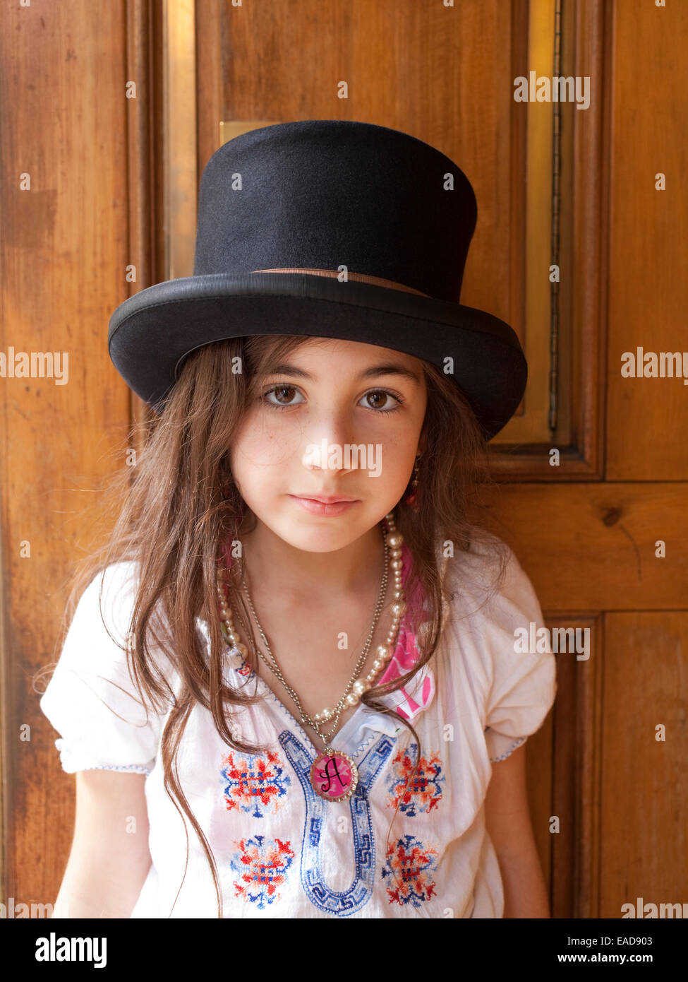 Young Girl In Top Hat - Stock Image