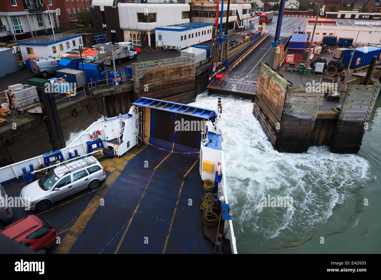 The Isle of Wight car ferry leaving dock at Portsmouth Harbour Stock Photo