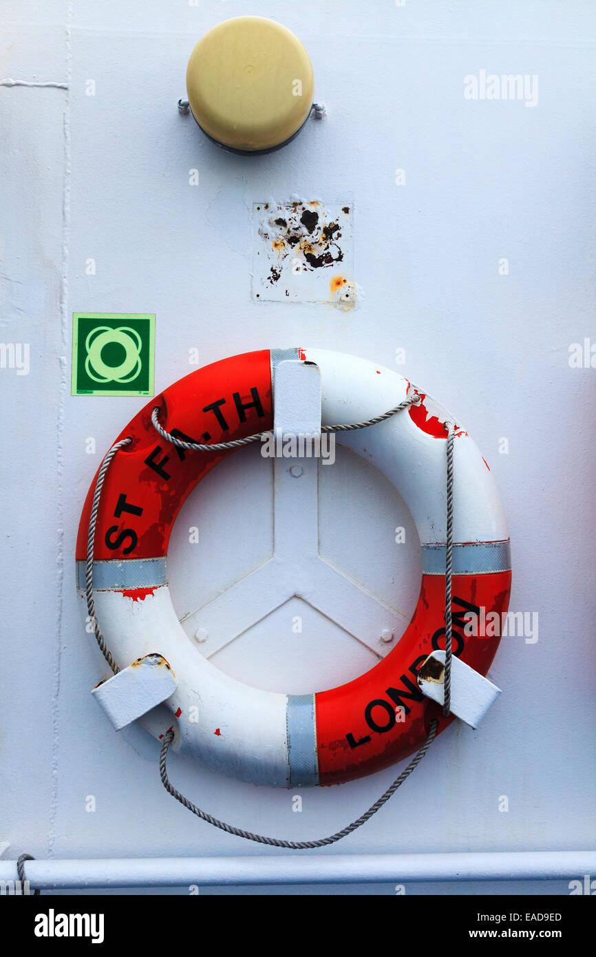 Lifebouy ring on bulkhead of ferry Stock Photo