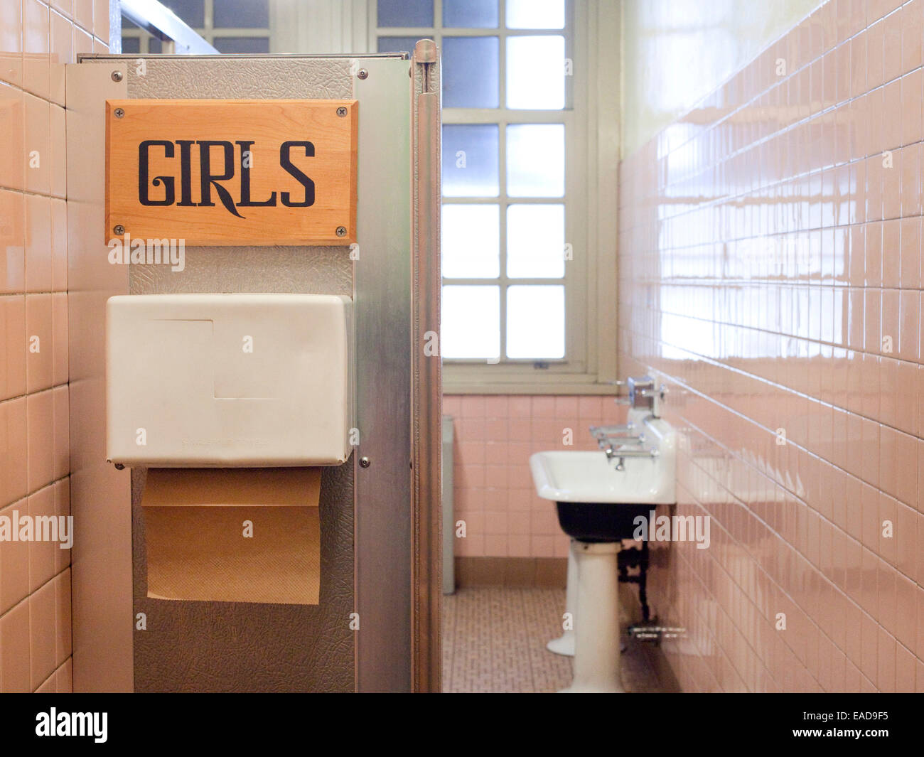 Pink Girl's Bathroom at a school - Stock Image