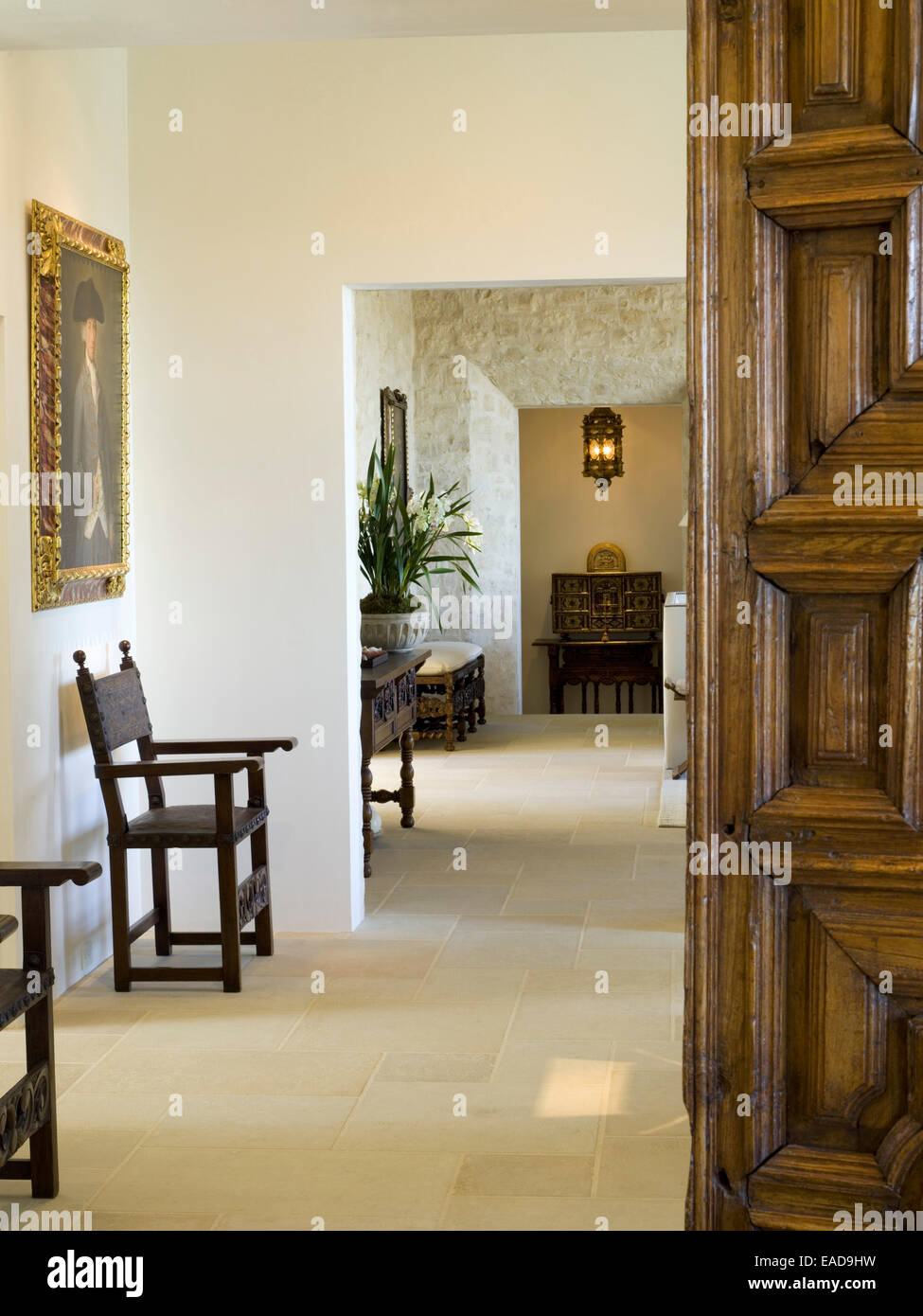 Hallway with carved wooden Door and Chairs - Stock Image