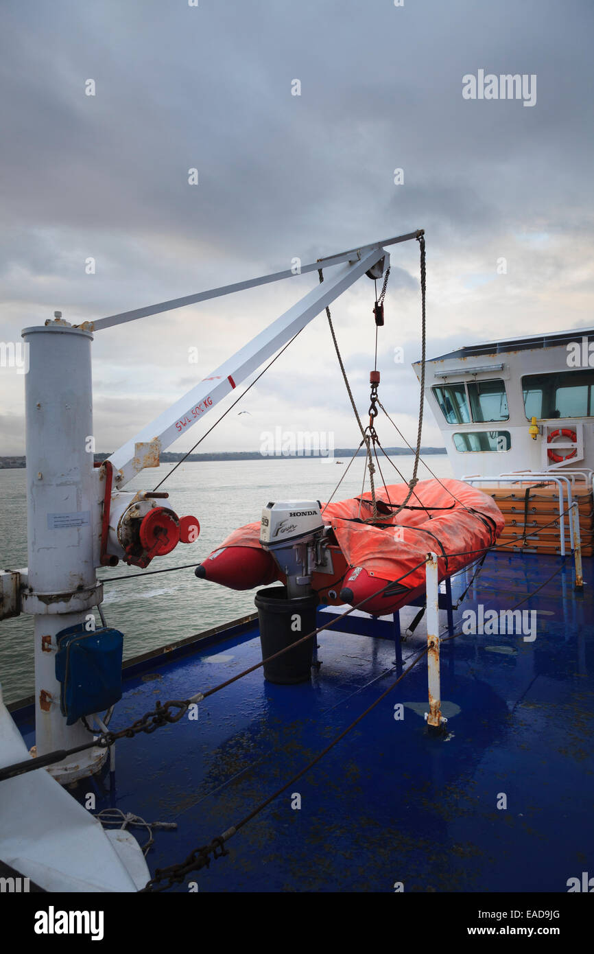 inflatable tender with Single Arm Slewing Boat/Raft Launching Applicance & Crane on ferry Stock Photo
