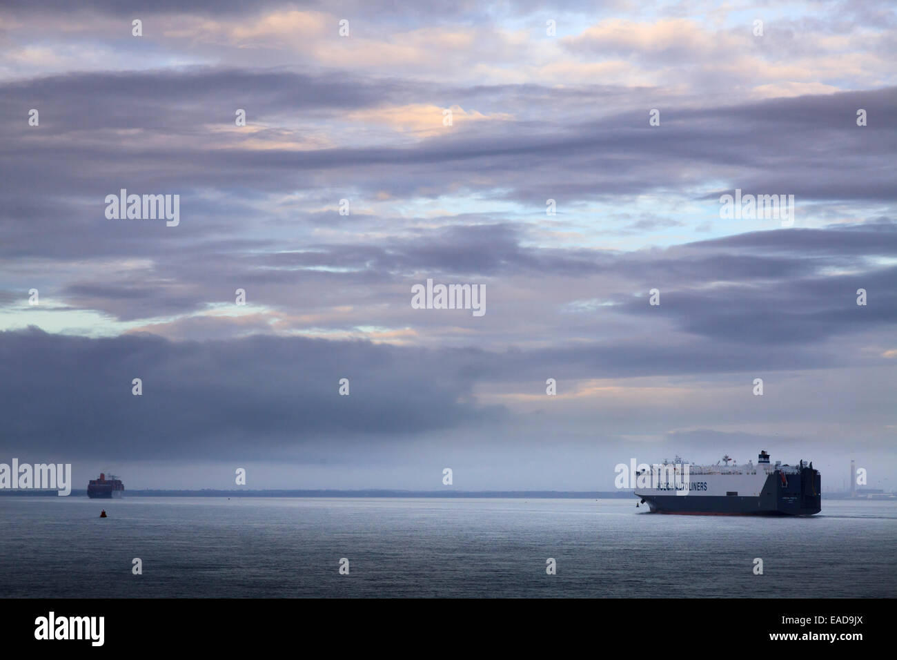 Hoegh Autoliners car transport ship heads up the Solent to Southampton at dawn Stock Photo