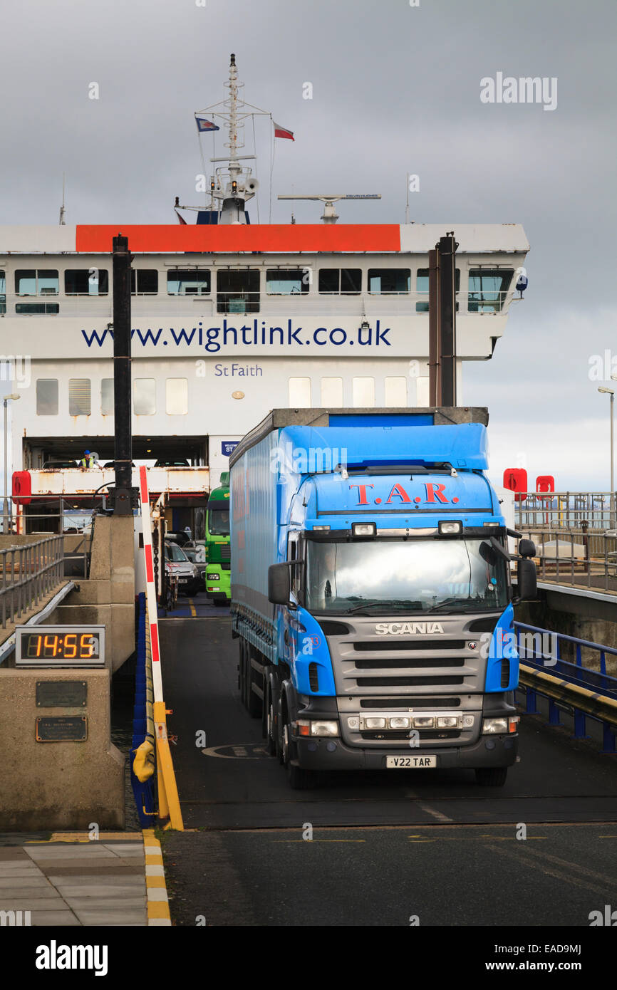 Trucks leaving a Wightlink car ferry up access ramp Stock Photo