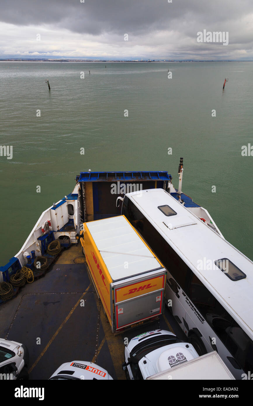 Truck, coach and vans on the foredeck of a Wightlink car ferry Stock Photo