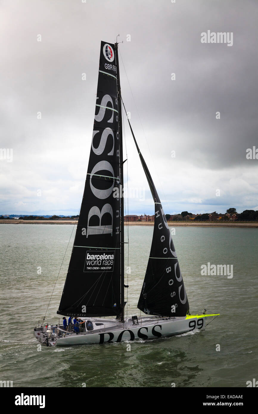 Boss racing yacht sailing back into harbour - Stock Image