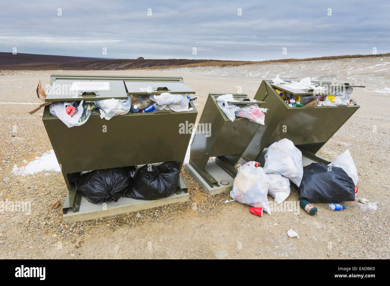 Over filled bear proof trash containers along the James Dalton Highway, Arctic North Slope, Alaska. - Stock Image