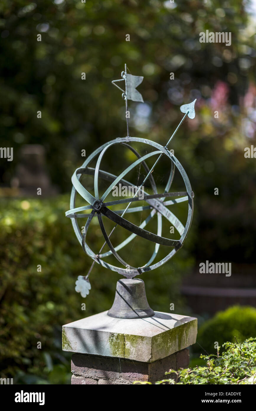An Armillary sphere at The Royal Observatory, Greenwich, London shows a model of the celestial sphere. - Stock Image