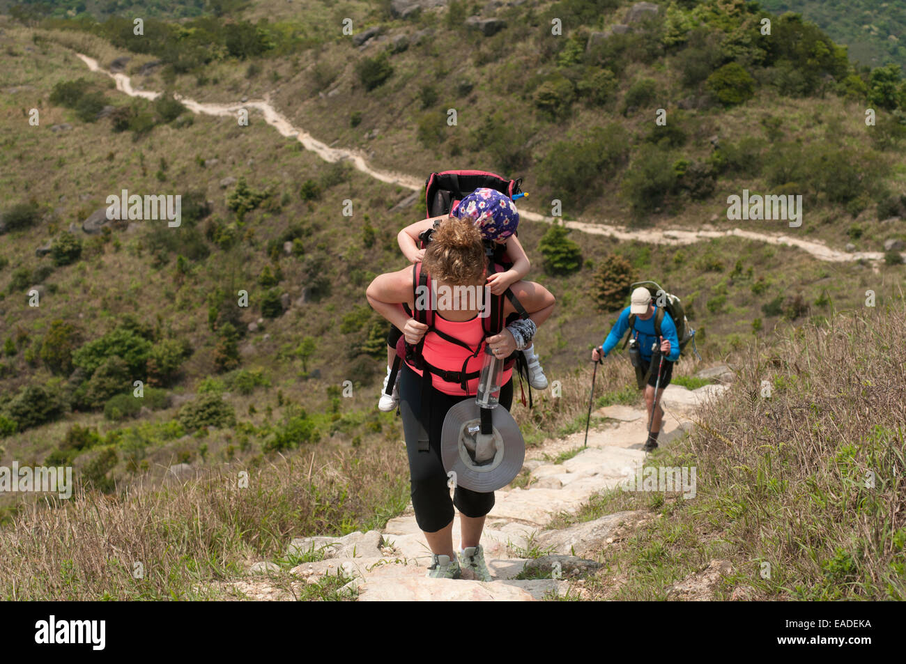 Hikers walking up the steep trails of Sunset Peak, Tai Tung Shan, located on Lantau Island Hong Kong China - Stock Image
