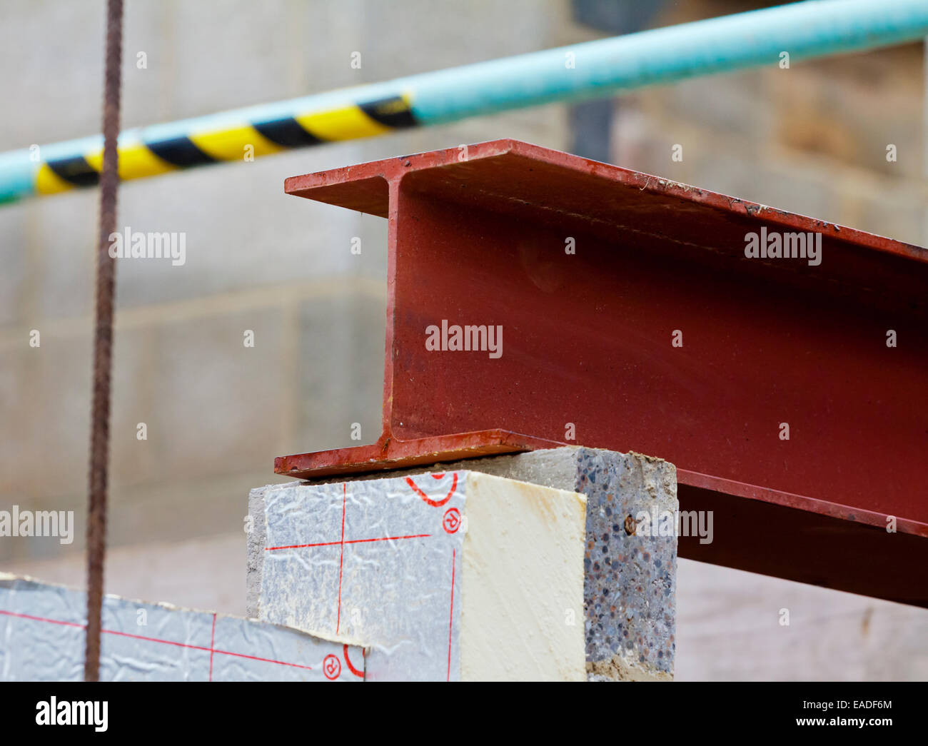 Metal girder laid on top of breeze blocks on a building site - Stock Image