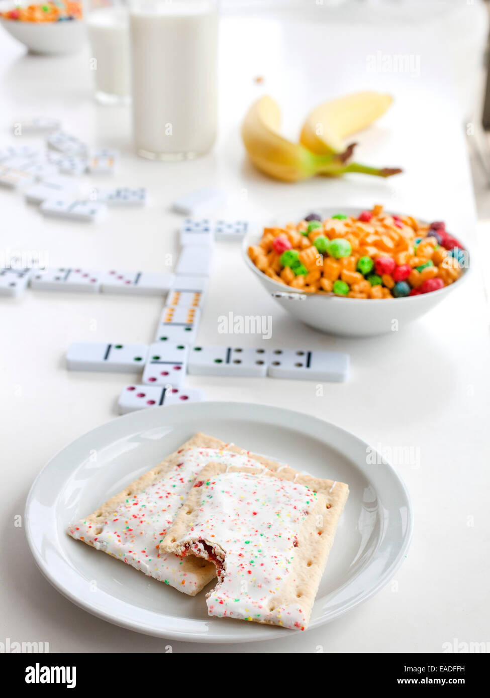 Pop Tarts and breakfast on table with games - Stock Image