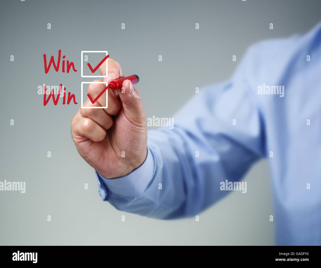 Checklist on whiteboard with businessman hand drawing win-win and a check mark in both checkbox - Stock Image