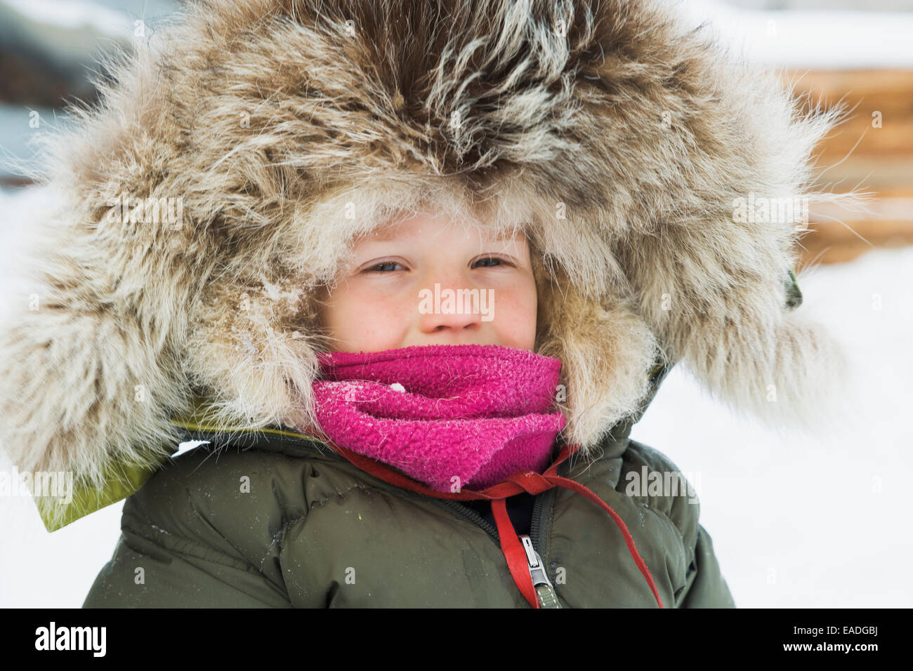 Young boy dressed in a winter parka with a wolf ruff, Wiseman, Arctic Alaska - Stock Image