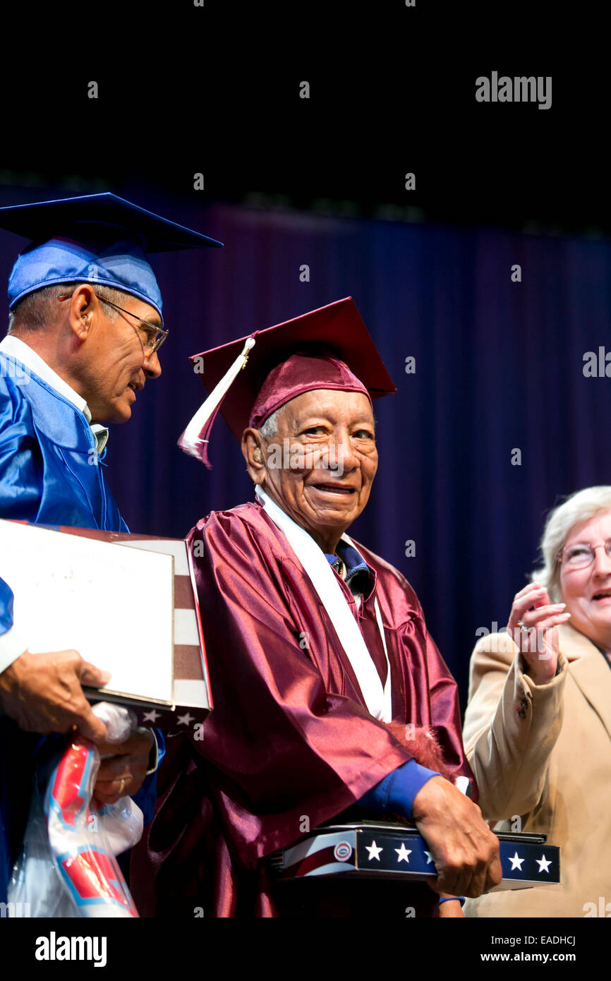 Ceremony for US military war veterans receiving honorary high school diplomas as they were never able to finish - Stock Image