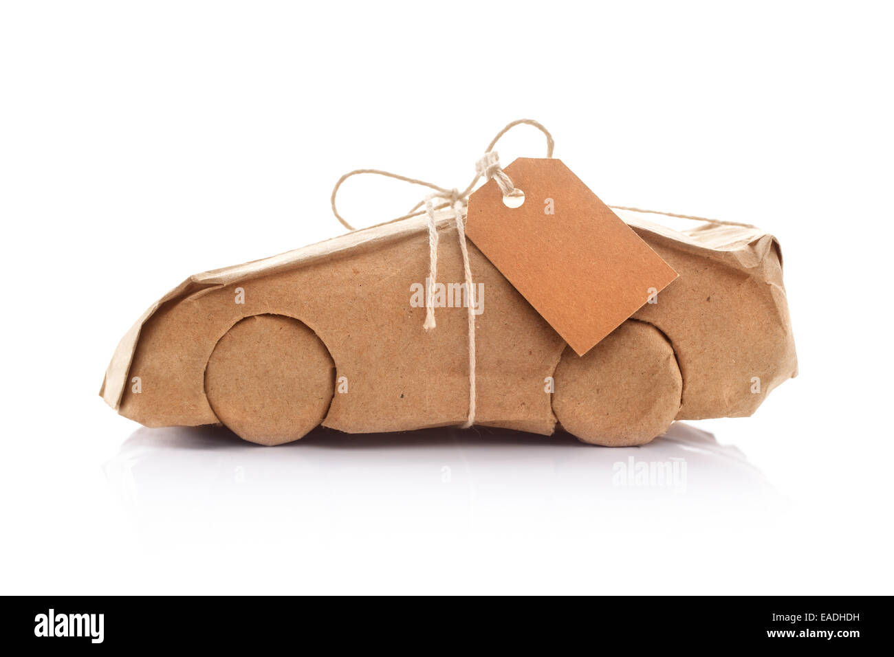 Car wrapped in brown paper - Stock Image