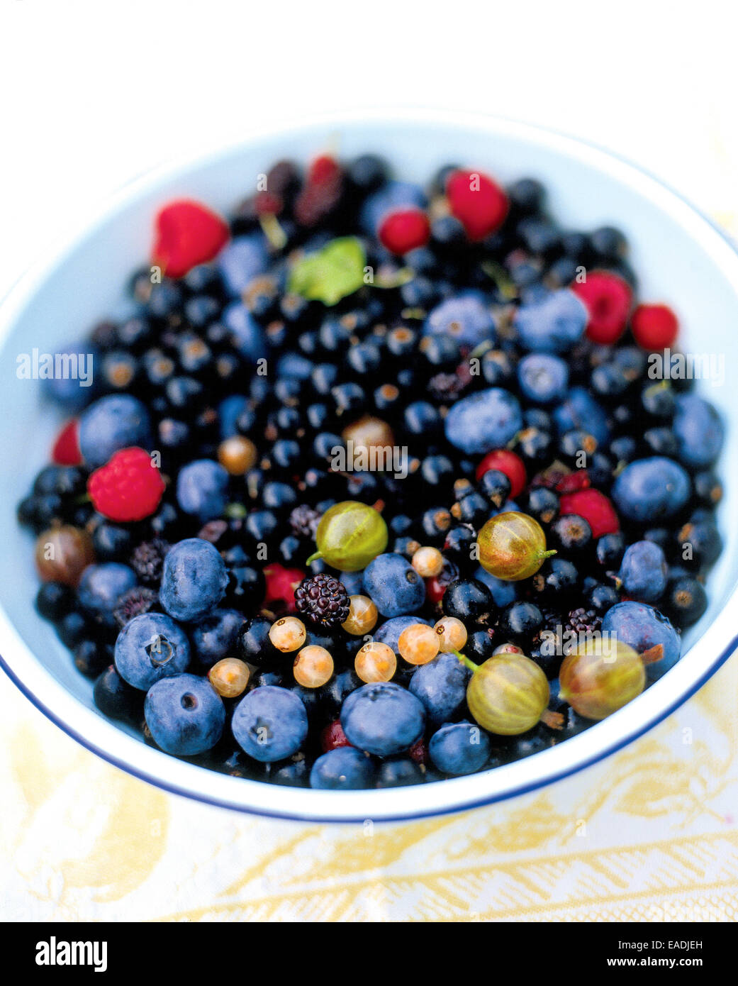 Various Mixed berries in a bowl - Stock Image