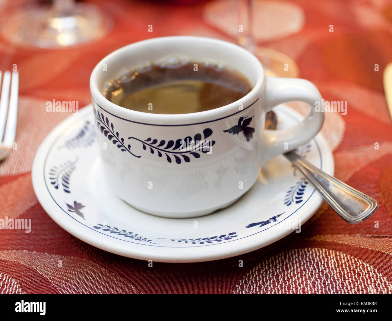 black coffee in ceramic cup and saucer - Stock Image