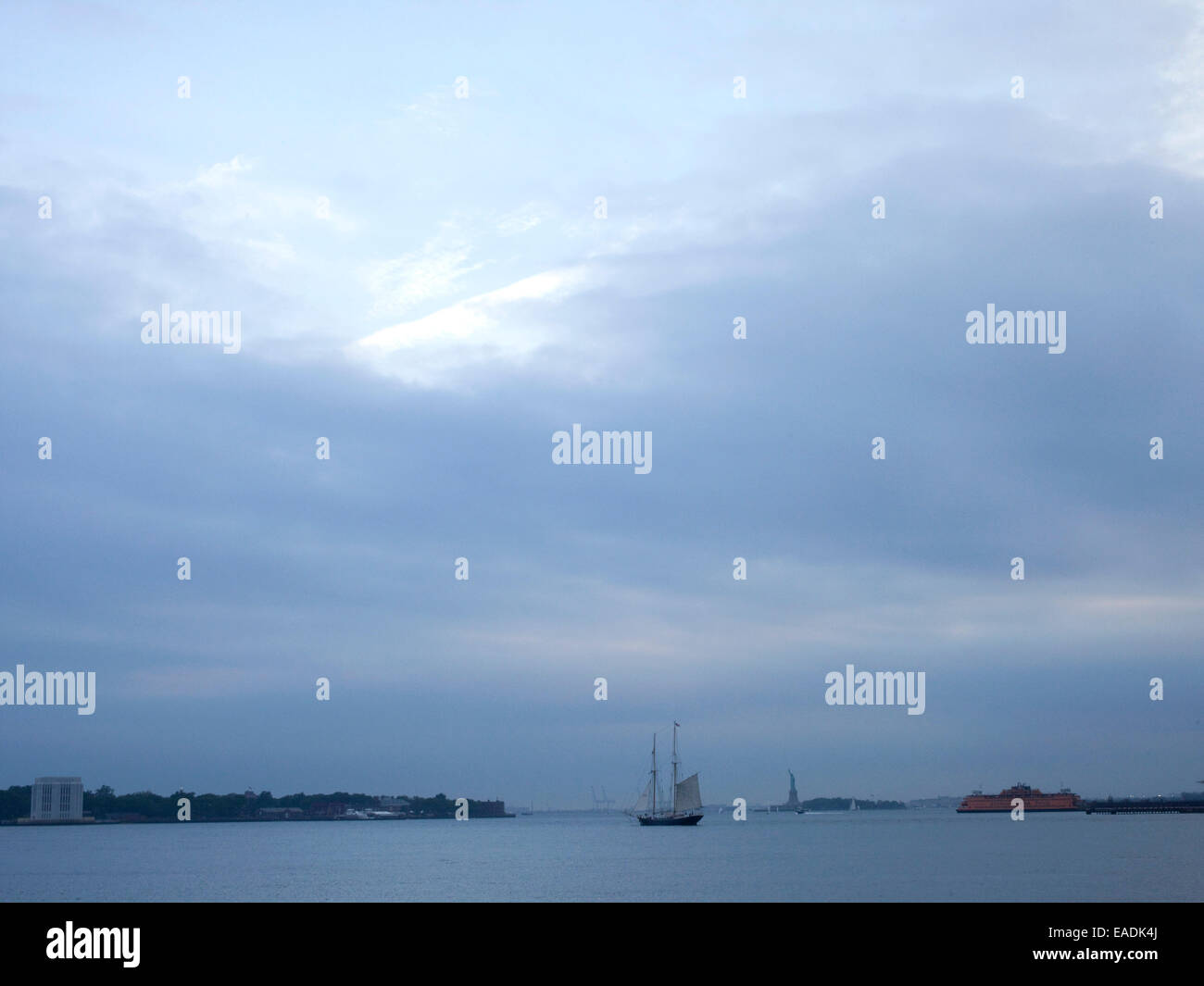 New York City Harbor with sail boat and statue of liberty - Stock Image