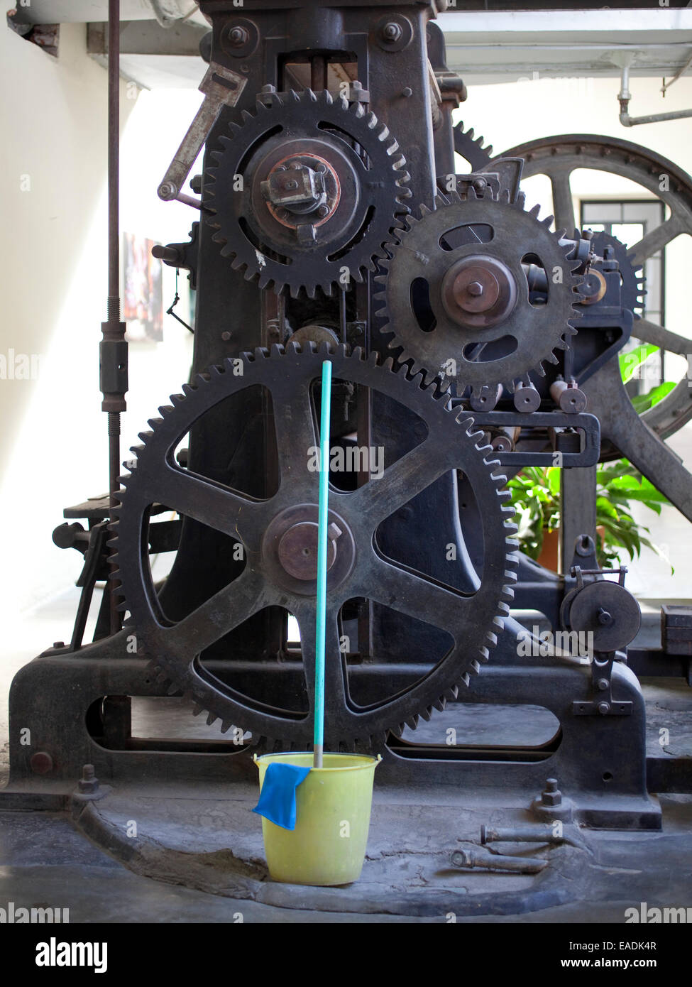 Room with Old Machine Gears and mop and bucket Stock Photo