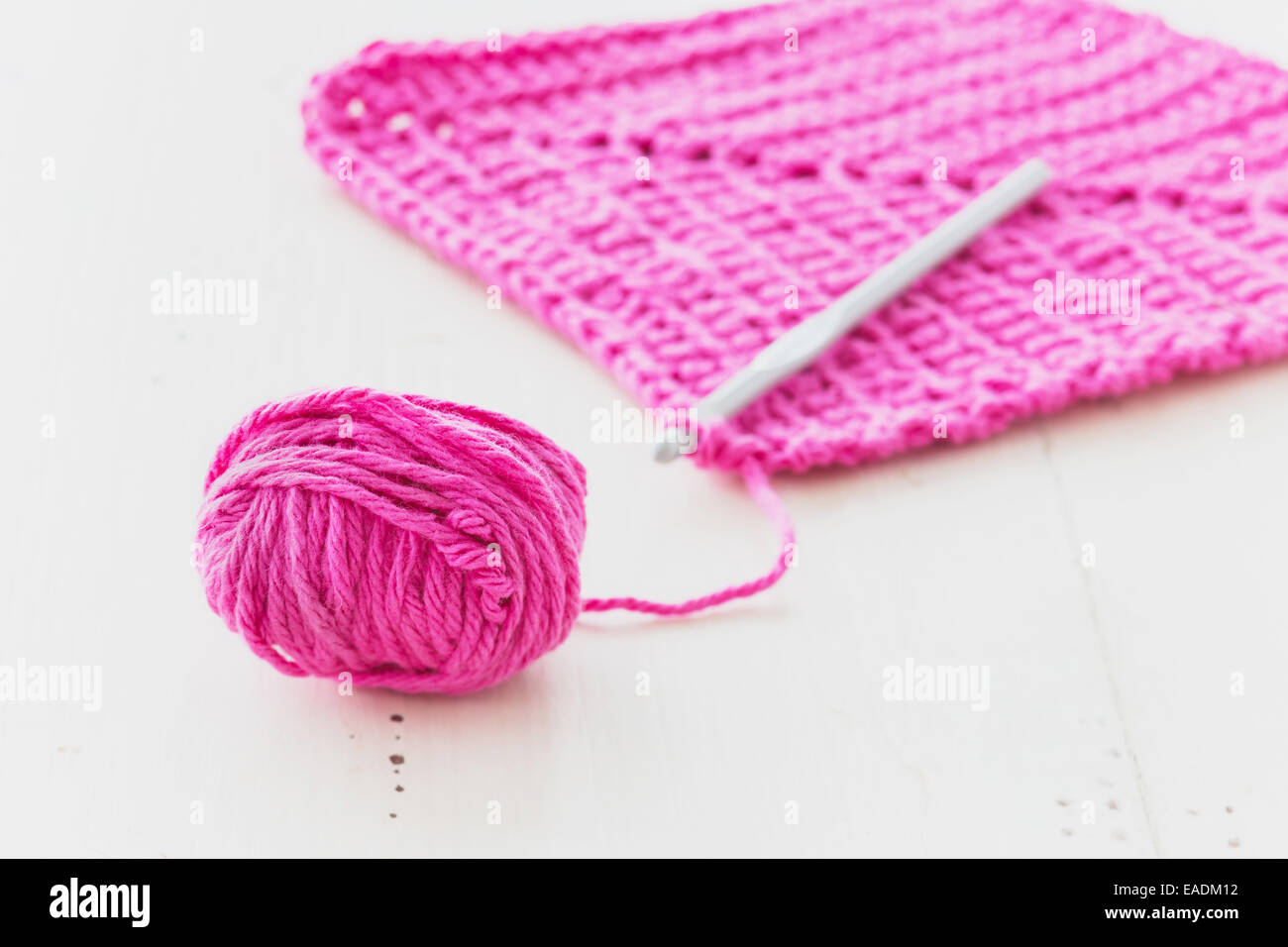 Homemade crocheted dishcloth with crochet hook and - Stock Image