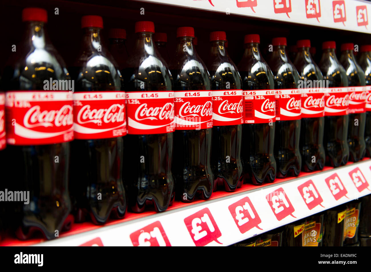 Coca cola coke bottles on sale in a supermarket. - Stock Image