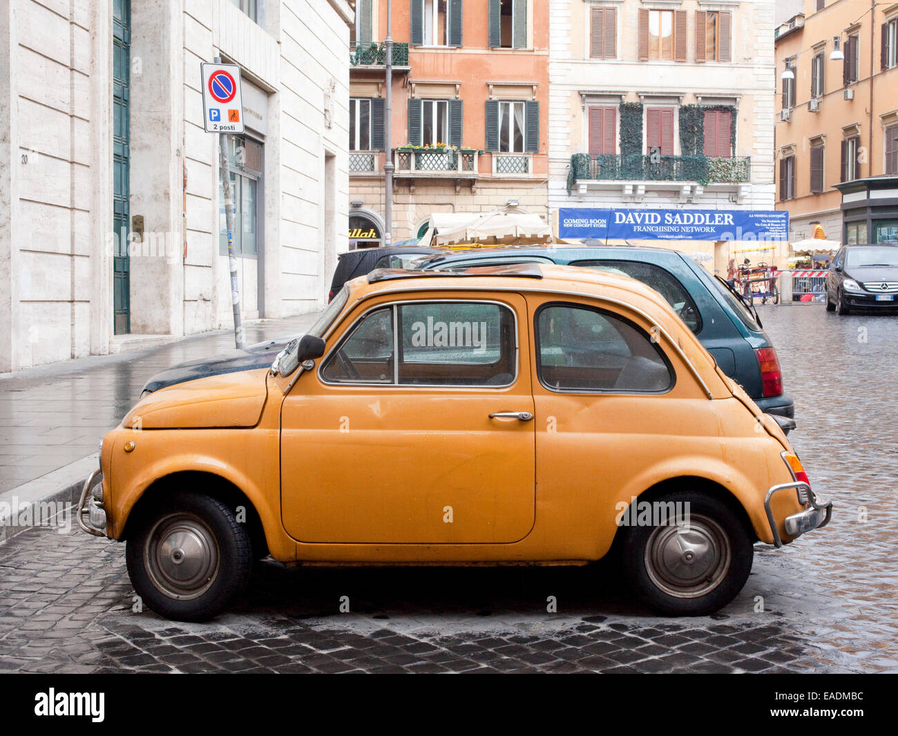 parked orange Fiat, Rome, Italy - Stock Image