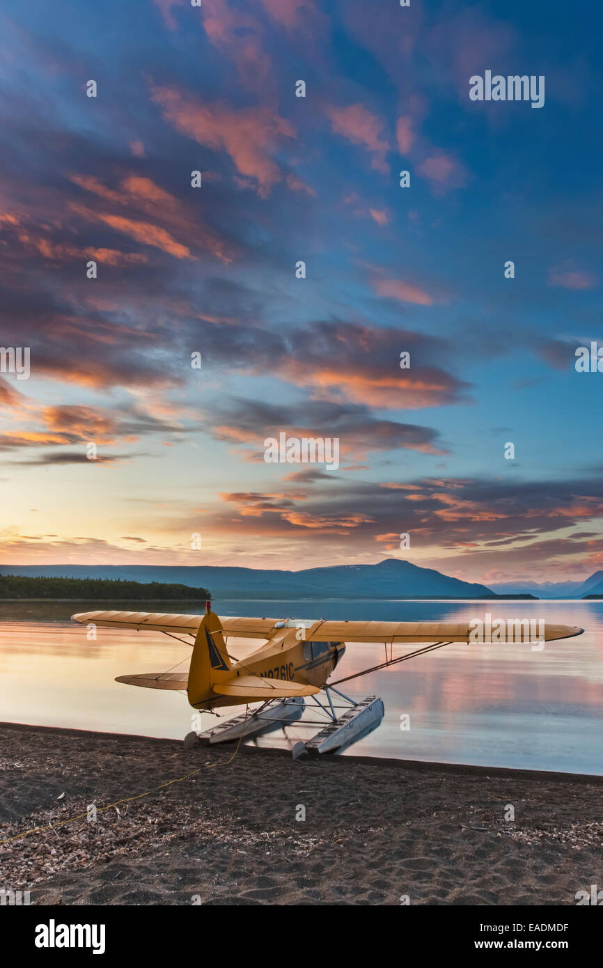 Morning sunrise over Naknek lake with a Super Cub bush plane on floats along the shore, Katmai National Park, southwest - Stock Image