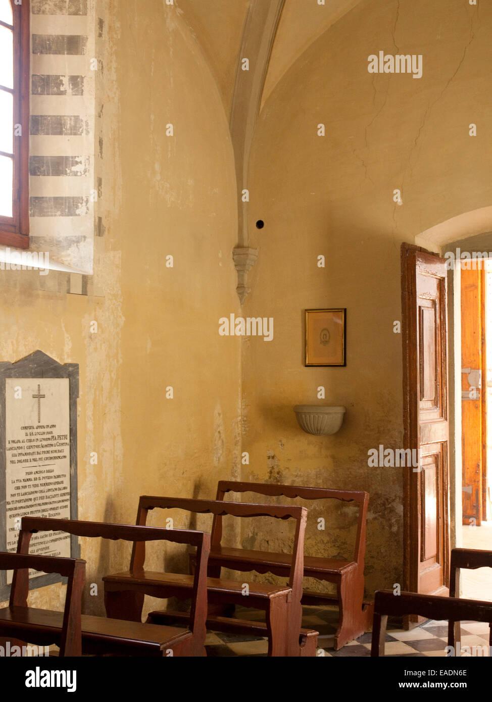pews in small Italian church Stock Photo