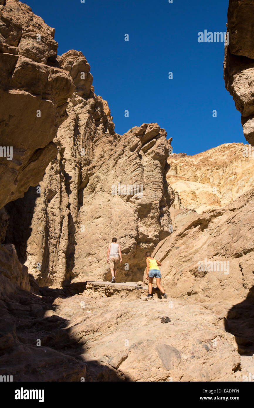 Tourists in Red Canyon in Death Valley which is the lowest, hottest, driest place in the USA, with an average annual - Stock Image