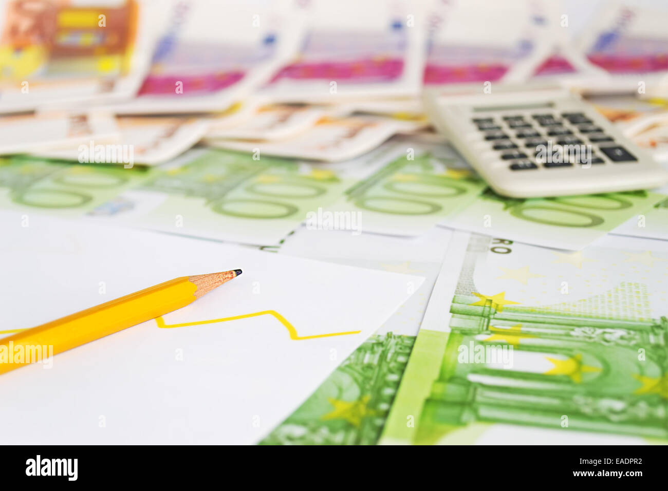 pencil and diagram on euro bills Stock Photo