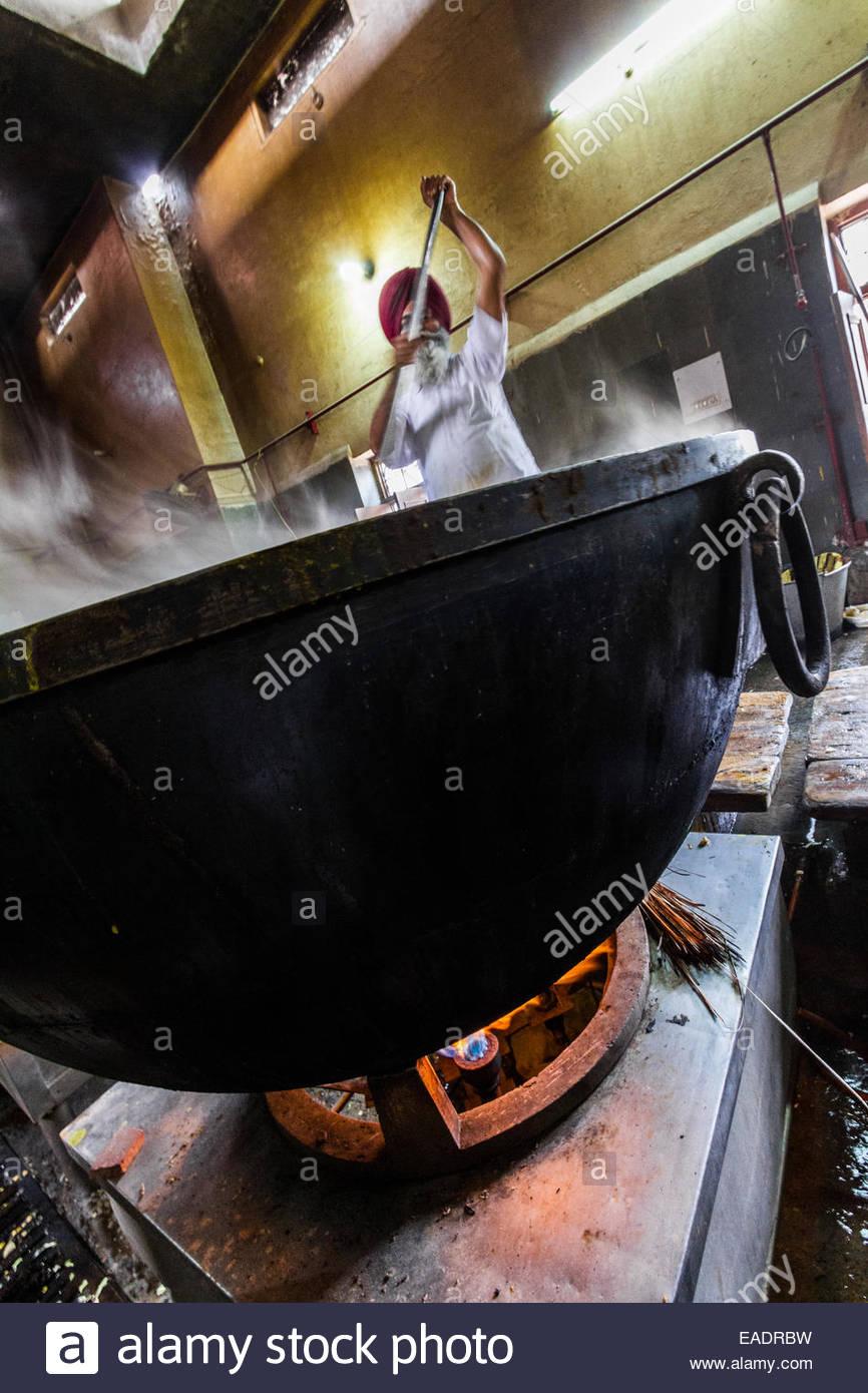 Man preparing food in langar - India - Stock Image