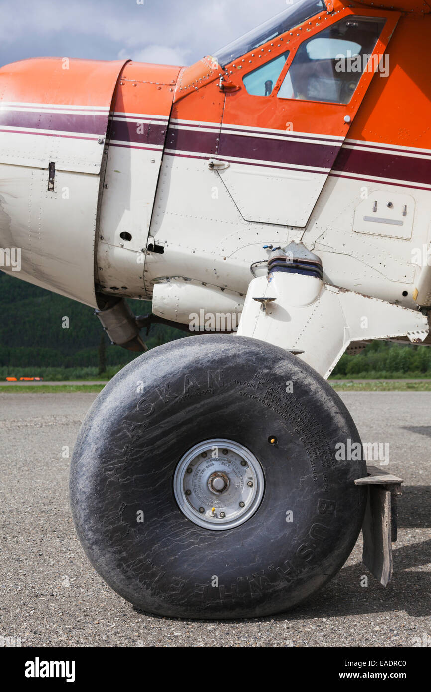 Coyote Air De Havilland Beaver airplane with tundra tires for landing on rugged surfaces. - Stock Image