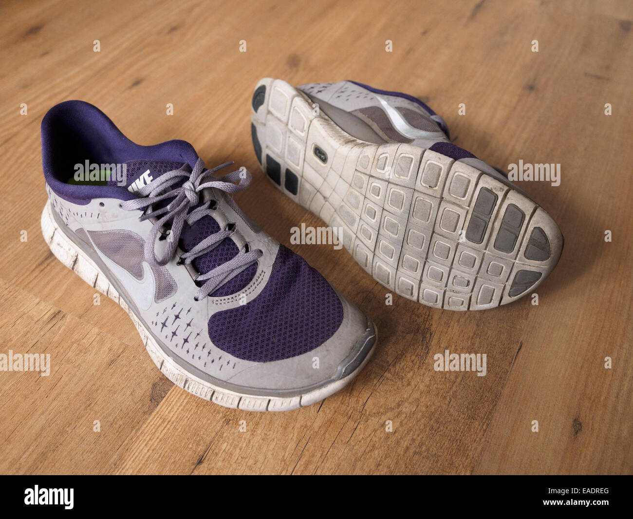 Old Nike Free Run grey and purple training shoes Stock Photo