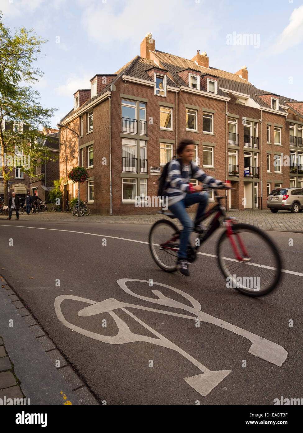 Man riding his bicycle on a bike lane in Maastricht, The Netherlands, Europe - Stock Image
