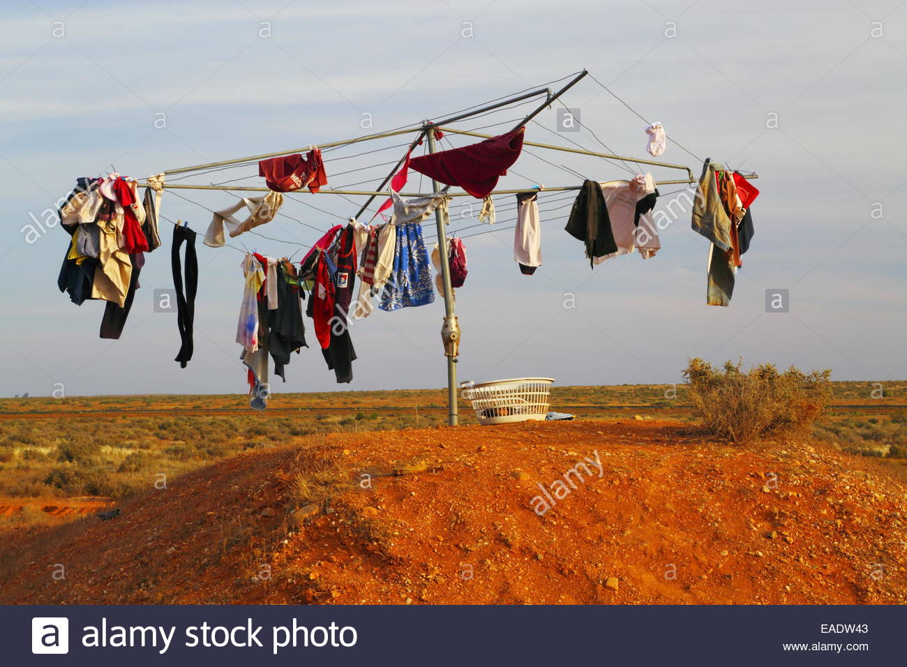 A Hills Hoist clothesline in the Outback. A joyful oddity along the highway's edge in South Australia. - Stock Image