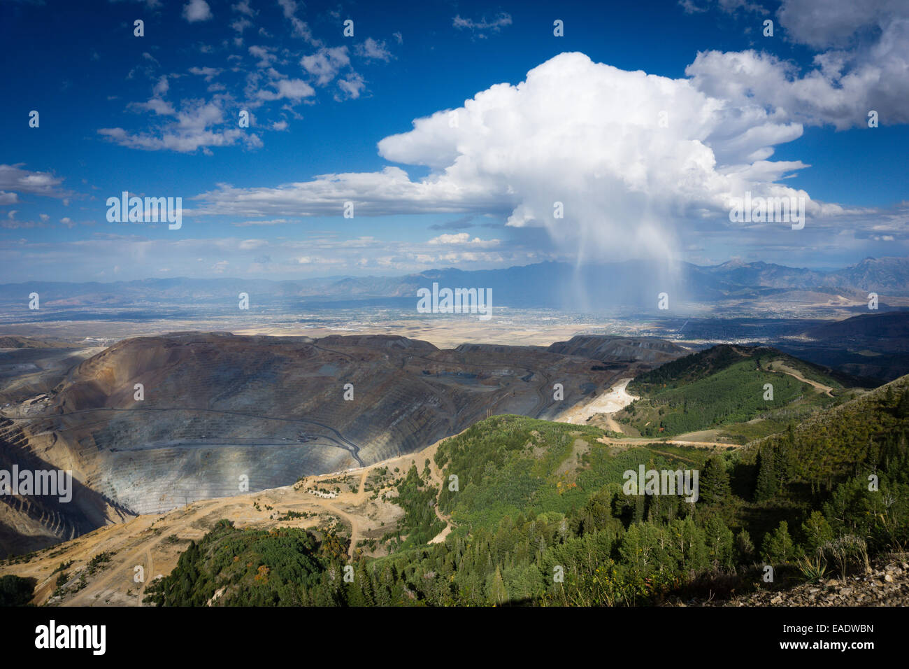 The Bingham Canyon Copper mine outside of Salt Lake City, Utah, with a squall in the distance. - Stock Image