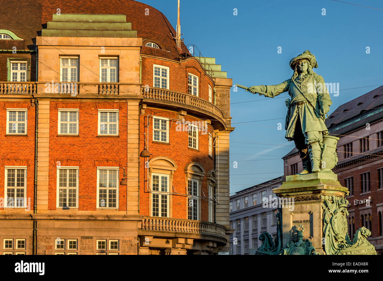 Statue of the naval hero and admiral Niels Juel (1629-97) viewing over Holmen's Channel, Copenhagen, Denmark - Stock Image