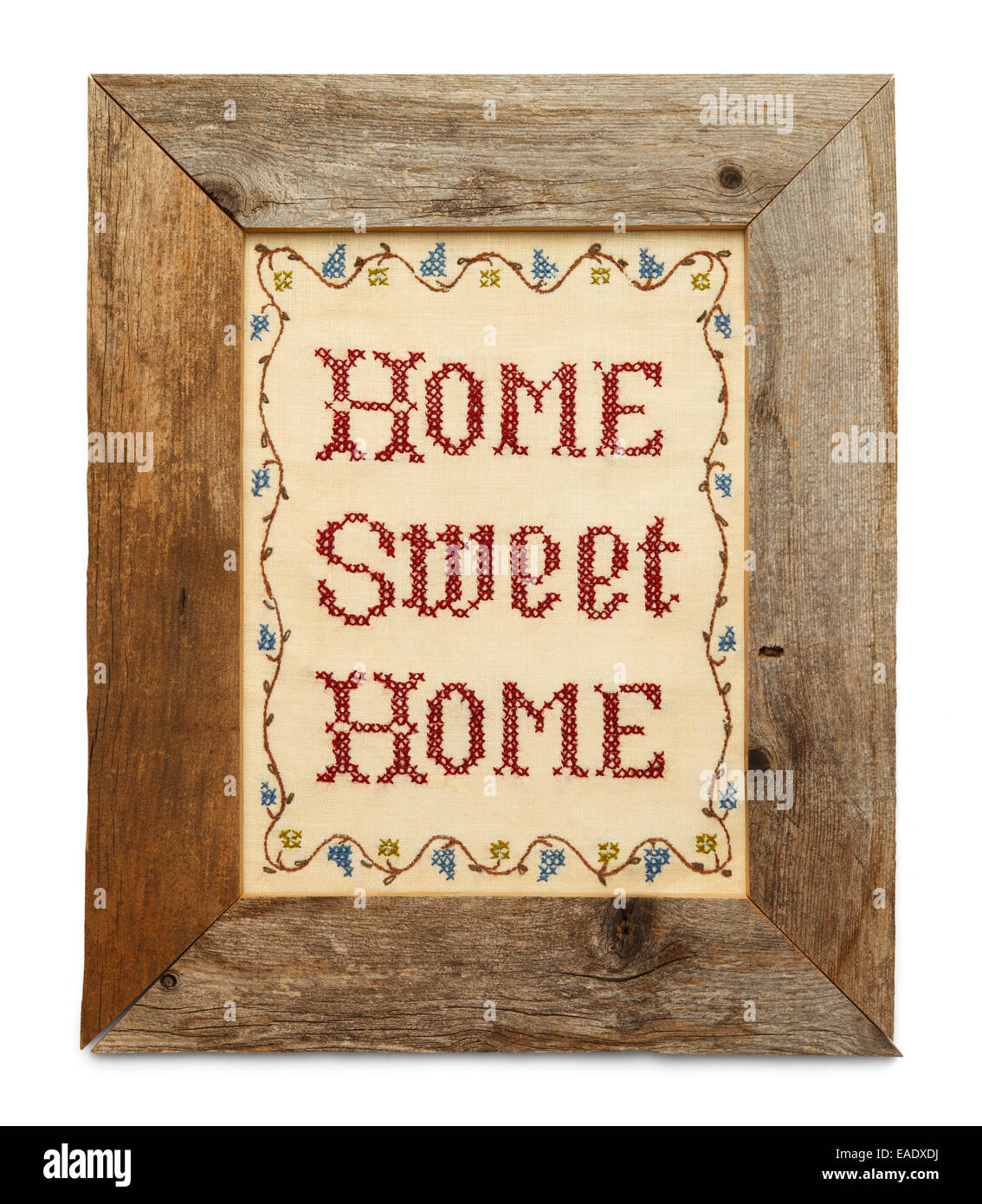Home Sweet Home Cross Stitch in Rustic Wood Frame Isolated on White Background. Stock Photo