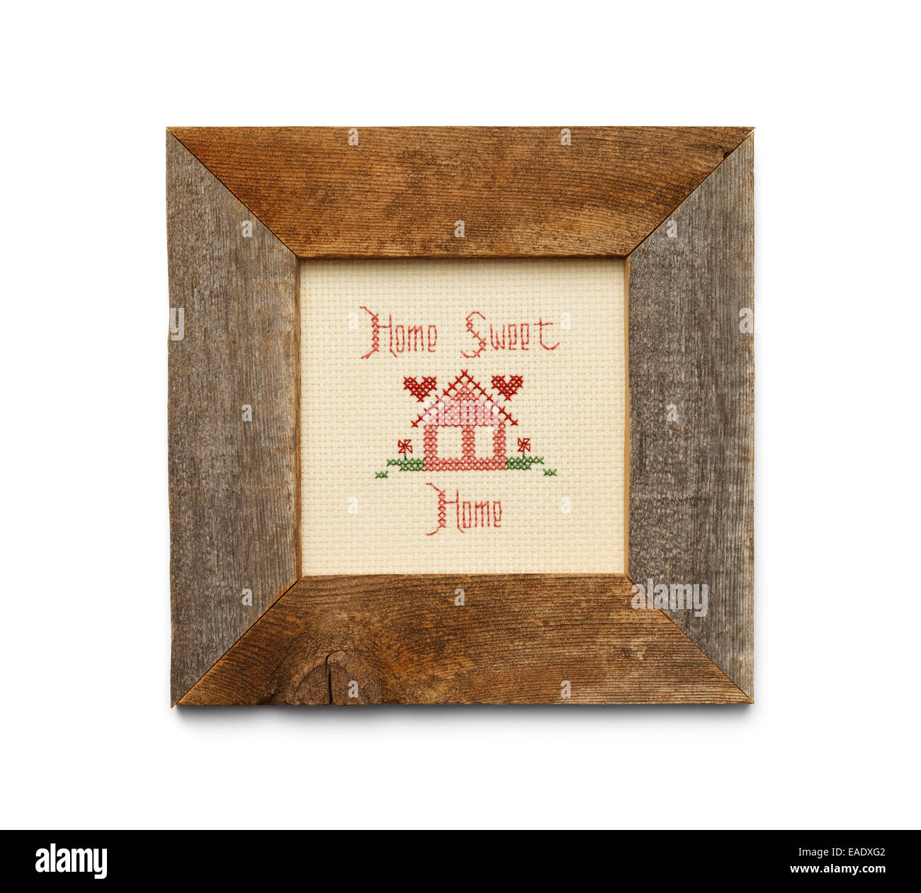 Home Sweet Home Cross Stitch in Square Wood Frame Isolated on White Background. Stock Photo