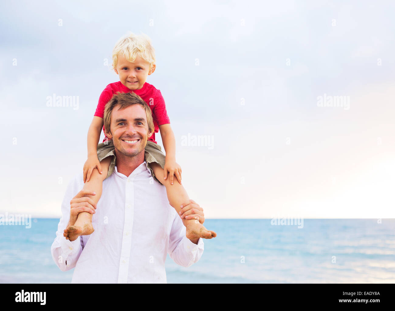 Father and Son Playing Having Fun on the Beach - Stock Image