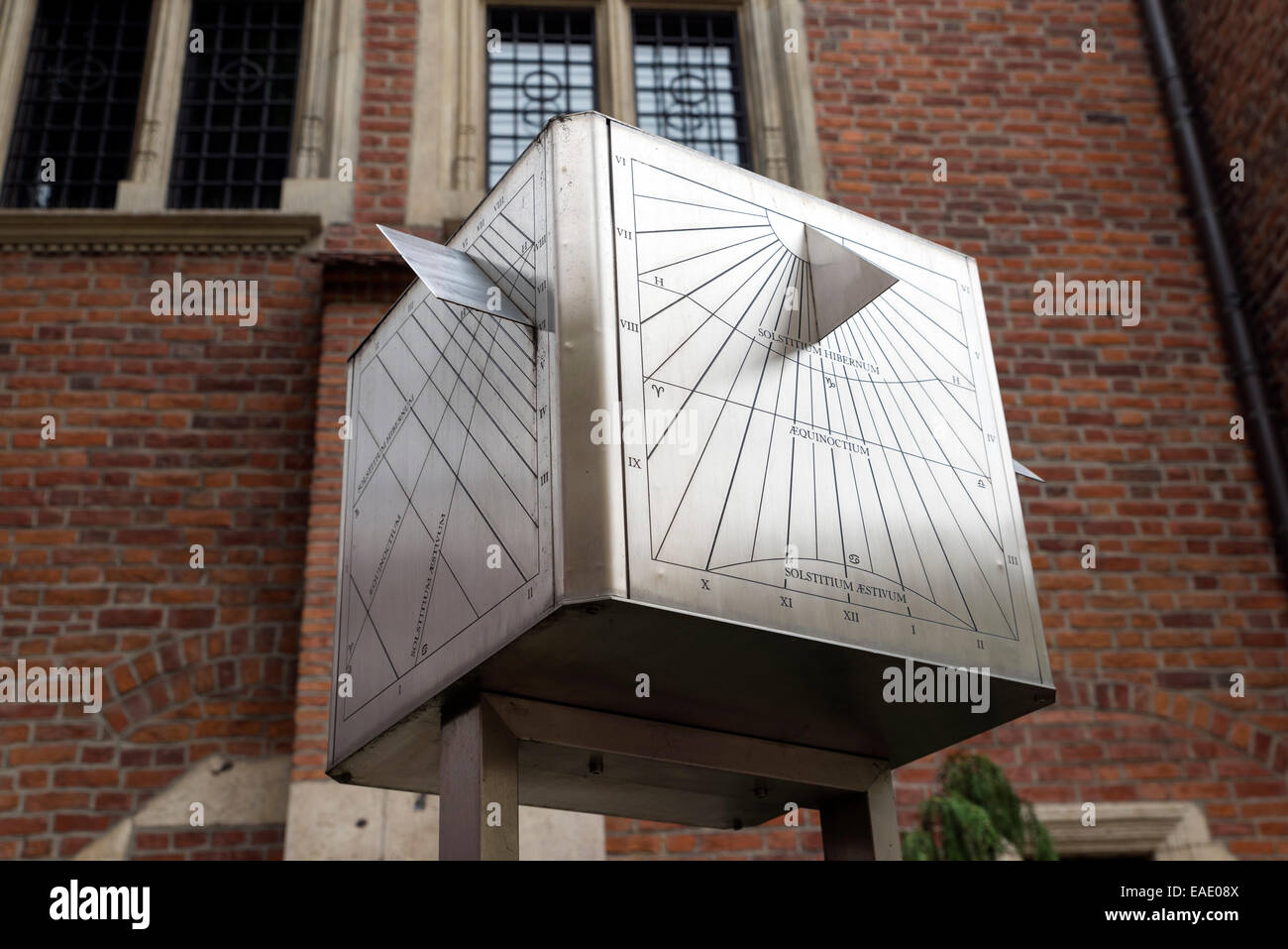 KRAKOW, POLAND - OCTOBER 26, 2014: A large cube in front of the facade of the university. A sophisticated sundial - Stock Image