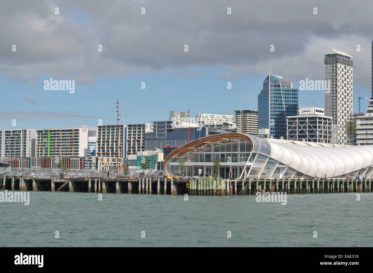 Auckland downtown from sea showing commercial wharves and The Cloud multi-functional venue with high-rise buildings - Stock Image