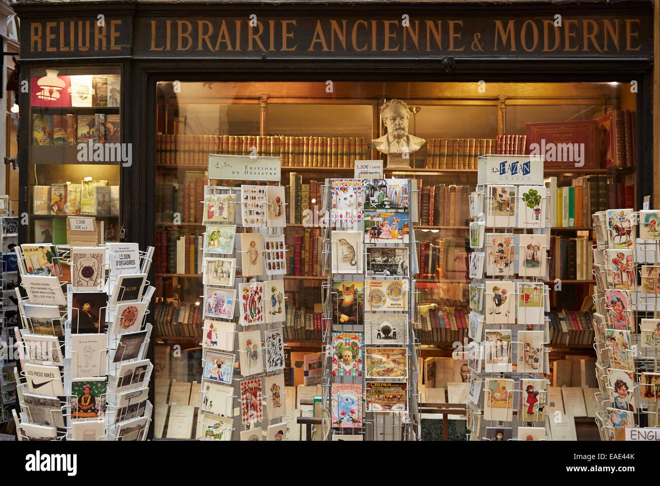 Paris, old bookshop in Galerie Vivienne with ancient book and postcards - Stock Image