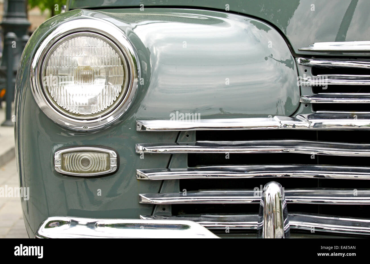 Front lamp and chrome bumper of an old vintage classic car - Stock Image