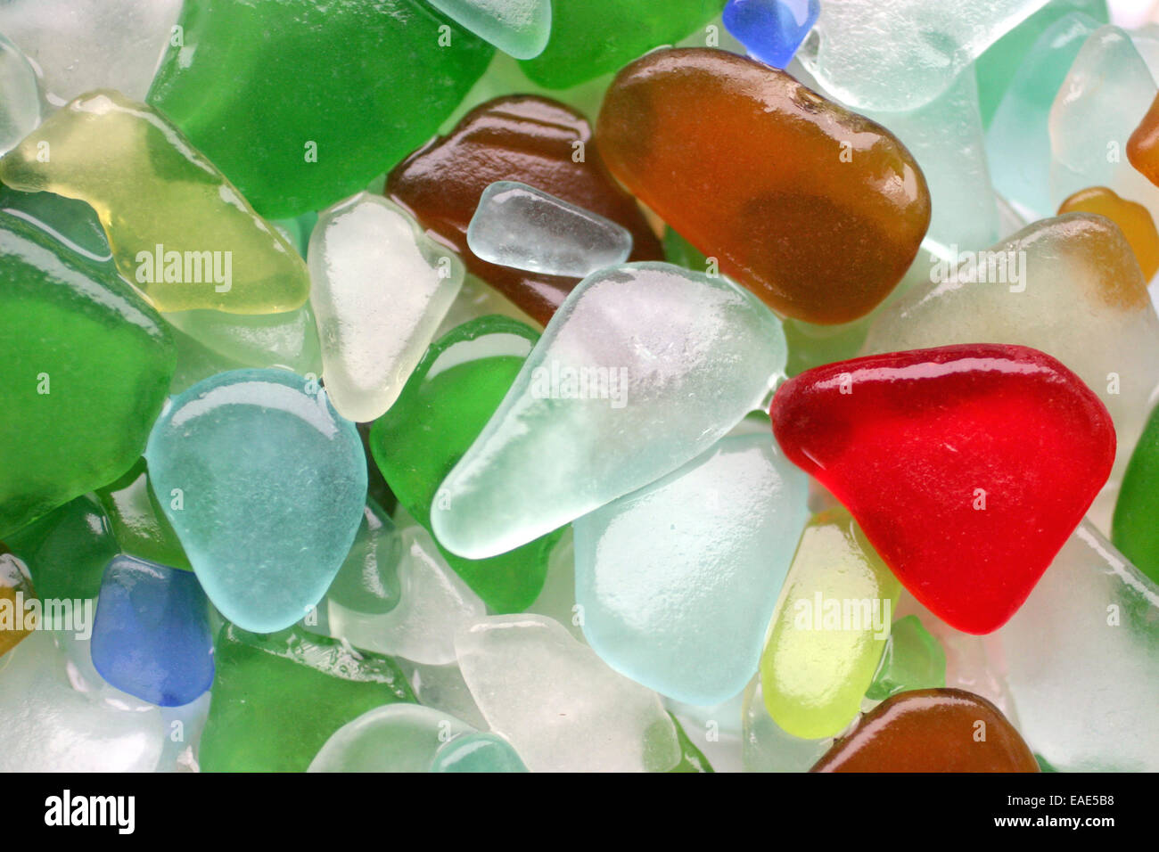 Colorful sea glass stones as natural background - Stock Image