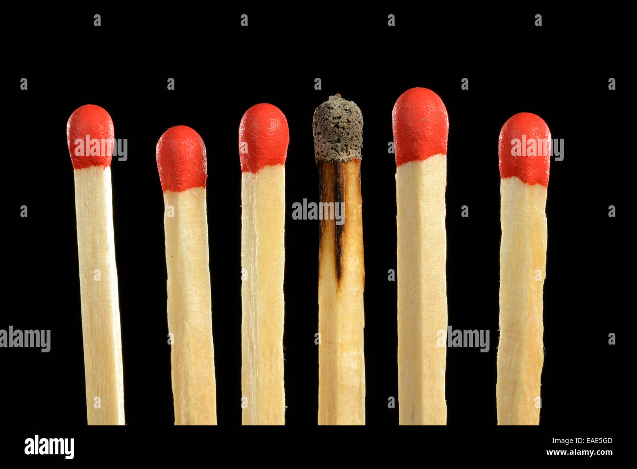 Matches with one burnt match head, symbolic image of burn-out, bullying, exclusion, loner, Germany - Stock Image