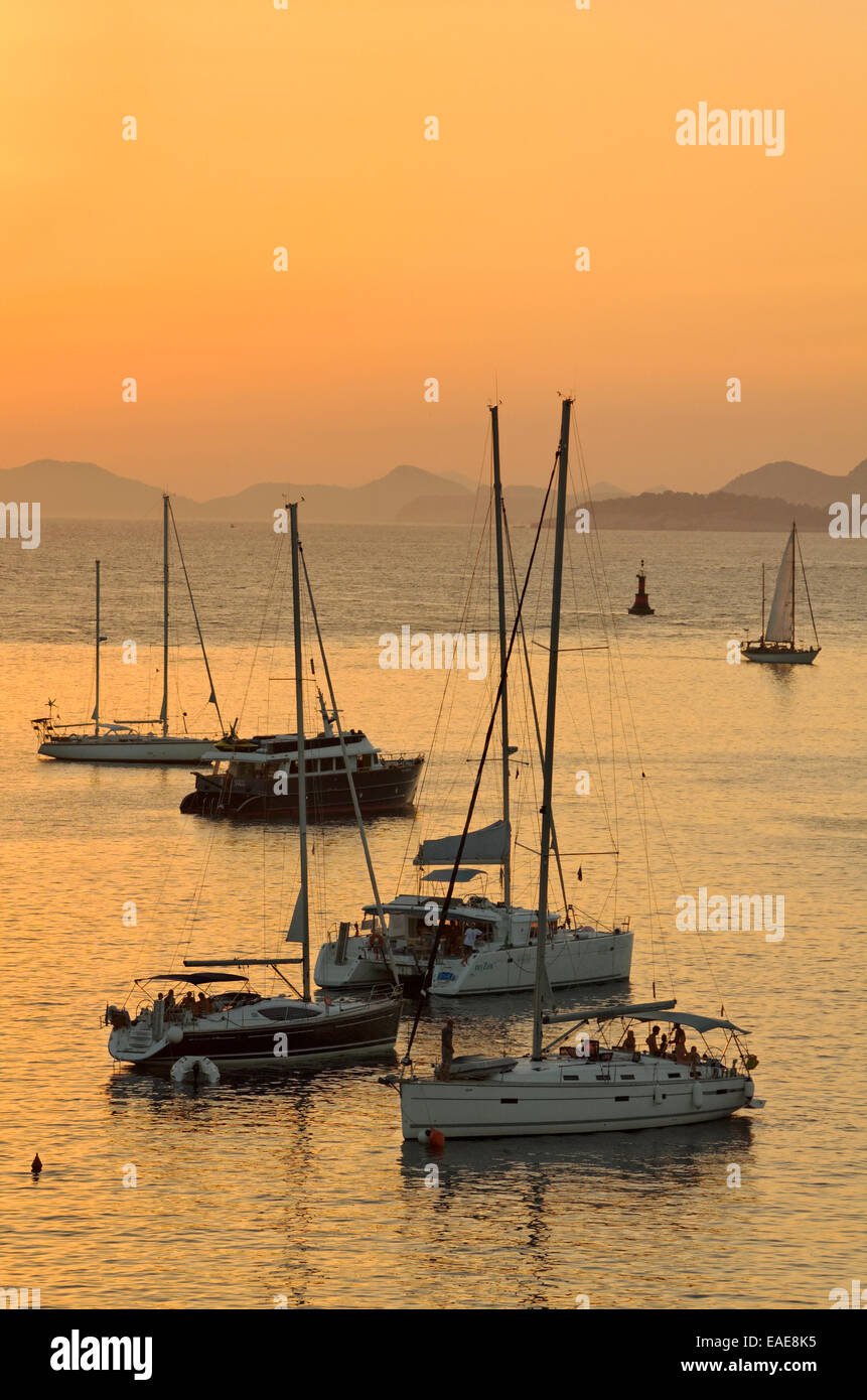 Yachts anchored in Cavtat, south of Dubrovnik, Croatia. A port of entry for private boats arriving or departing - Stock Image