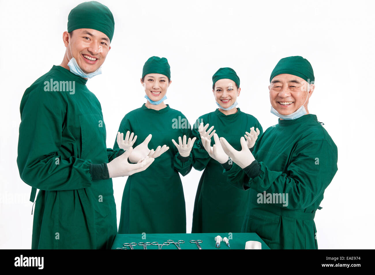 Four portrait of doctors on white background - Stock Image
